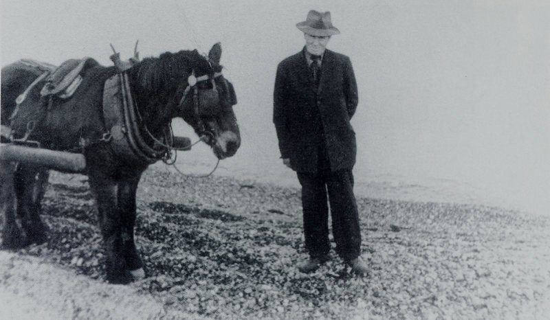Thomas Foley collecting gravel at the North Beach. Source Derek Paine